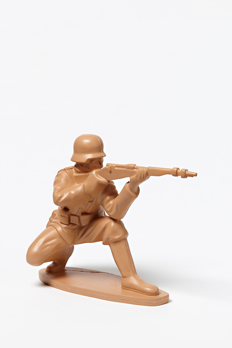 German Soldier in Crouching Position with Rifle